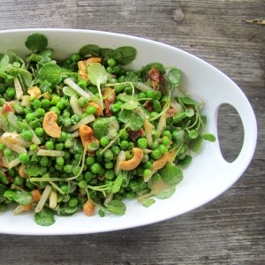 Sweet Baby Pea Salad with cashews, bacon, scallions, watercress, water chestnuts, and vinaigrette. Simple holiday side dish.
